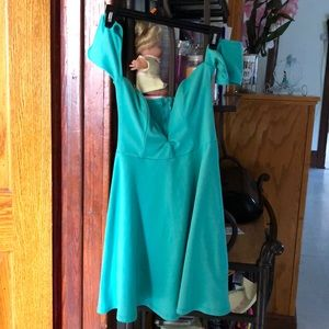 Dresses & Skirts - A mid thigh mint color dress. ( only used once).